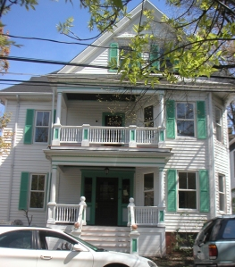 Front view of Banks Street house after renovation. Upstairs porch was opened up and original porch railings recreated.